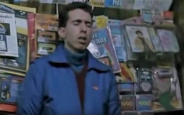 "A still from the movie ""Ragazzi Fuori"" where it is easy to see the pirated C64 compilations being sold at a newspaper kiosk"